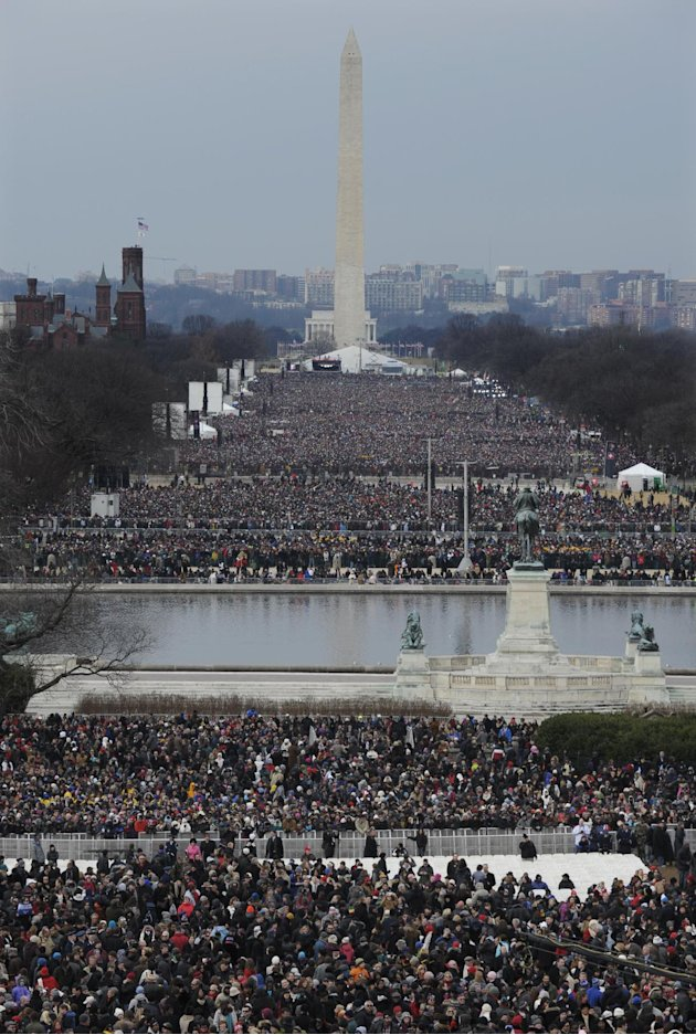 Crowds congregate in The National Mall for the ceremonial swearing-in for President Barack Obama at the U.S. Capitol during the 57th Presidential Inauguration in Washington, Monday, Jan. 21, 2013. (AP