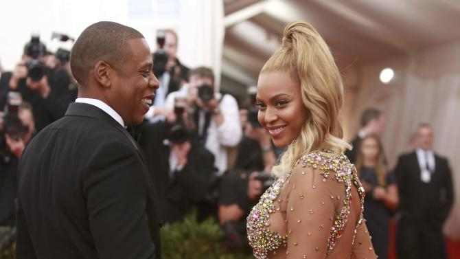 "Singer Beyonce smiles next to her husband, rapper Jay Z, as they arrive for the Metropolitan Museum of Art Costume Institute Gala 2015 celebrating the opening of ""China: Through the Looking Glass,"" in Manhattan"