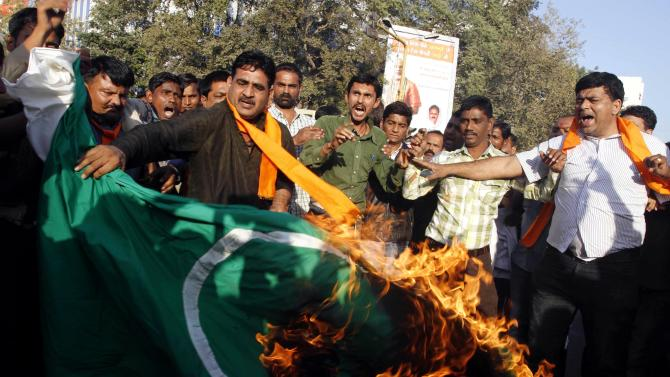 Activists of the right wing Hindu nationalist Vishwa Hindu Parishad, or World Hindu Council, burn a Pakistani flag during a protest in Ahmadabad, India, Thursday, Jan. 10, 2013. The Pakistani army said one of its soldiers was killed Thursday when Indian troops fired at a post across the disputed Kashmir border. It is the third incident of violence across the Kashmir border in recent days, raising tension between archenemies Pakistan and India. (AP Photo/Ajit Solanki)