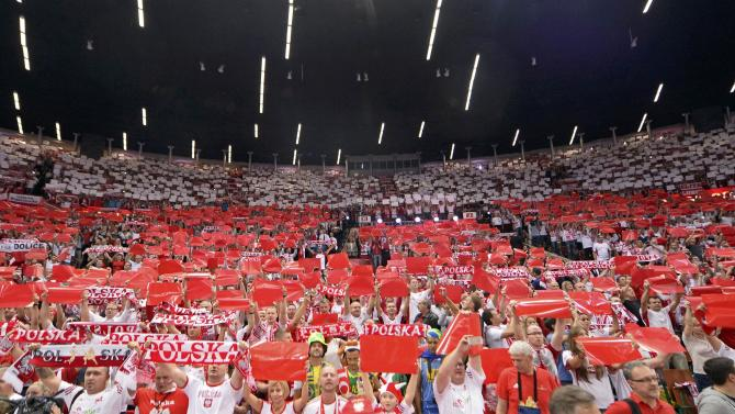 Poland's supporters cheer their team before their final match against Brazil at the FIVB Volleyball Men's World Championship Poland 2014 at Spodek Arena in Lodz