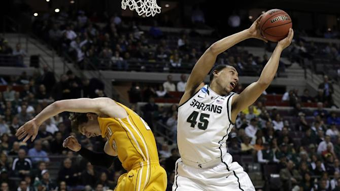 Michigan State guard Denzel Valentine (45) grabs a rebound over Valparaiso guard Matt Kenney (23) in the first half of a second-round game of the NCAA college basketball tournament in Auburn Hills, Mich., Thursday March 21, 2013. (AP Photo/Paul Sancya)