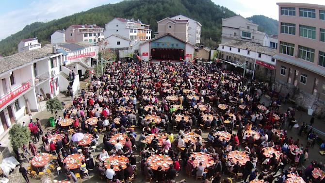 Villagers have lunch to celebrate the Spring Festival, in Taizhou
