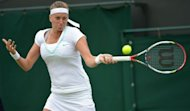 Czech Republic's Petra Kvitova plays a forehand shot during her fourth round women's singles match against Italy's Francesca Schiavone on day seven of the 2012 Wimbledon Championships tennis tournament at the All England Tennis Club in Wimbledon, southwest London. Kvitova won 4-6, 7-5, 6-1