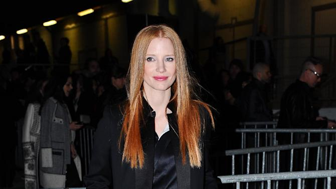 Actress Jessica Chastain arrives at Givenchy's Ready to Wear's Fall-Winter 2013-2014 fashion collection presented Sunday, March 3, 2013 in Paris. (AP Photo/Zacharie Scheurer)