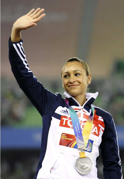 Britain's Jessica Ennis celebrates with her silver medal on the podium during the medal ceremony for the Heptathlon at the World Athletics Championships in Daegu, South Korea, Tuesday, Aug. 30, 2011.