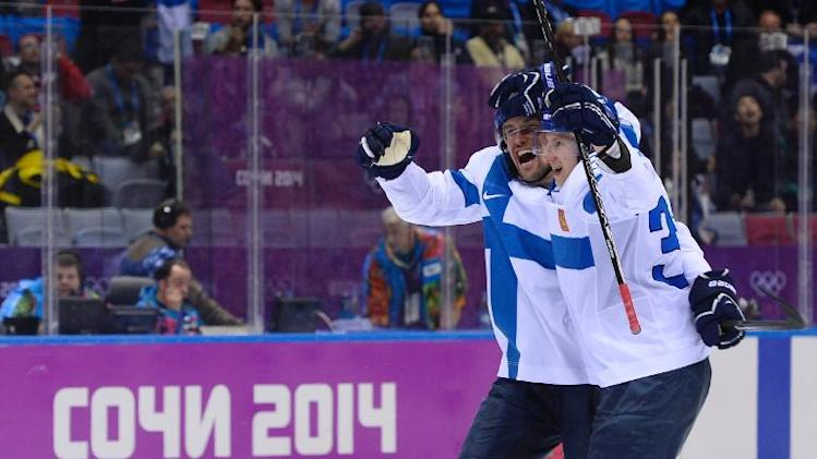 Finland's Teemu Selanne celebrates with teammates after scoring his team's fourth goal during the Men's ice hockey Bronze Medal Game against the USA at the Bolshoy Ice Dome during the Sochi Winter Olympics on February 22, 2014