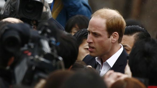 Britain's Prince William, Duke of Cambridge, talks to members of public at Chime of Hope Shopping Centre in Onagawa