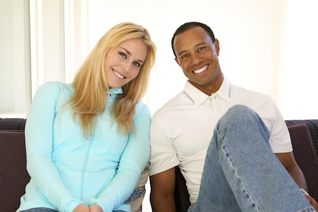 In this 2013 photo provided by Tiger Woods and Lindsey Vonn, golfer Tiger Woods and skier Lindsey Vonn pose for a portrait. Two months after rumors began circulating in Europe, Woods and Vonn posted s