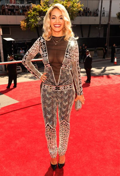 Woah; that's a lot of Rita Ora. Jay-Z's latest protégé hit the VMA red carpet in a head-to-toe embroidered and embellished Emilio Pucci jumpsuit with a cut-down-to-there black mesh V that revealed…a l