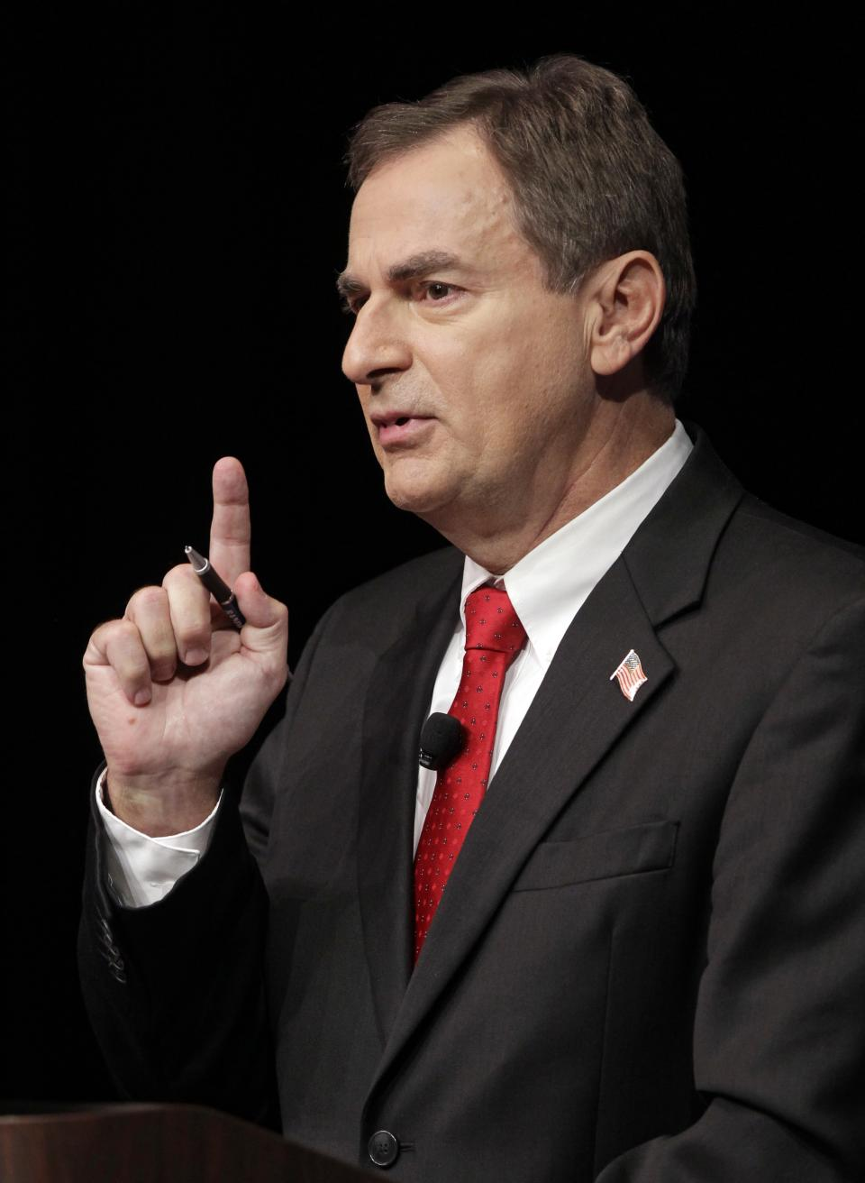 Republican Richard Mourdock, candidate for Indiana's U.S. Senate seat,  participates in a debate with Democrat Joe Donnelly  and Libertarian Andrew Horning in a debate in New Albany, Ind., Tuesday, Oct. 23, 2012. (AP Photo/Michael Conroy)