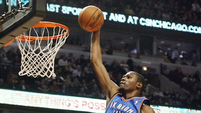 Oklahoma City Thunder small forward Kevin Durant scores on a breakaway during the first half of an NBA basketball game against the Chicago Bulls, Thursday, Nov. 8, 2012, in Chicago. (AP Photo/Charles Rex Arbogast)