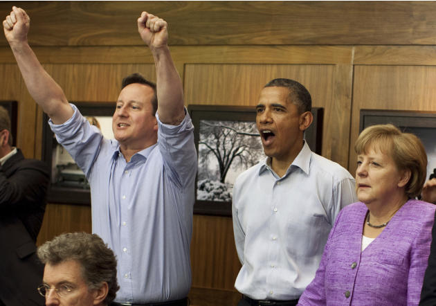 Britain's Prime Minister David Cameron,  President  Obama, and Germany's Chancellor  Merkel watch the overtime shootout of the Chelsea vs. Bayern Munich Champions League final in the Laurel Cabin conf