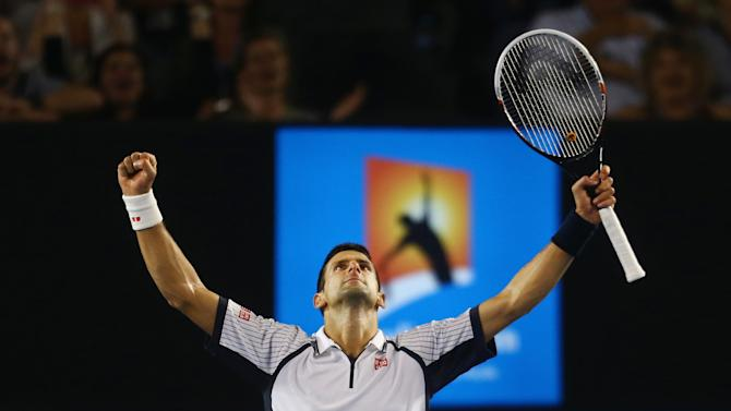 Serbia's Novak Djokovic celebrates his quarterfinal win over Tomas Berdych of the Czech Republic at the Australian Open tennis championship in Melbourne, Australia, Tuesday, Jan. 22, 2013. (AP Photo/ Scott Barbour,Pool)