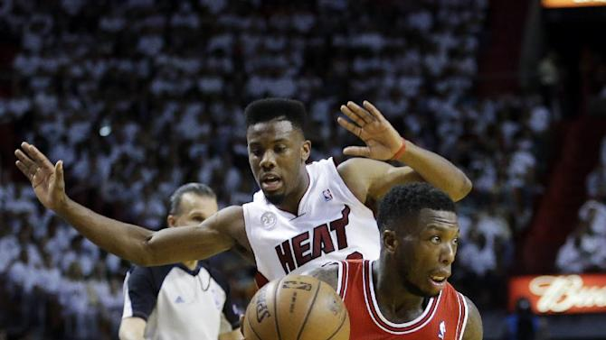 Chicago Bulls guard Nate Robinson (2) drives to the basket past Miami Heat guard Norris Cole during the second half of Game 1 of the NBA basketball playoff series in the Eastern Conference semifinals, Monday, May 6, 2013 in Miami. Robinson scored 27 points as the Bulls defeated the Heat 93-86. (AP Photo/Lynne Sladky)