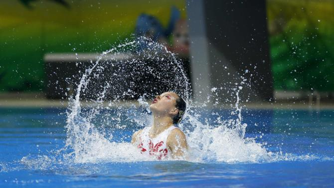 China's Huang Xuechen and Sun Wenyan perform during their women's duet synchronised swimming competition at Munhak Park Tae-hwan Aquatics Center during the 17th Asian Games in Incheon
