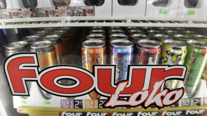 Four Loko and other alcoholic energy drinks are seen in the cooler of a convenience store Wednesday, Nov. 10, 2010, in Seattle. Following a vote by the state Liquor Control Board Wednesday morning, Washington state is banning the drinks effective Nov. 18. The ban comes after nine Central Washington University students were hospitalized after a party last month, where authorities say they drank the caffeinated malt liquor beverage Four Loko. (AP Photo/Elaine Thompson)
