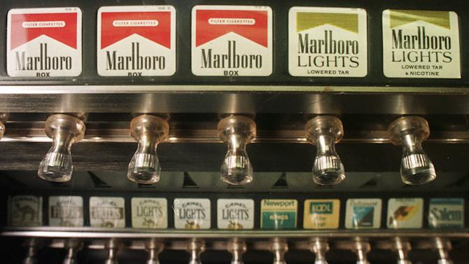 This Monday, Oct. 13, 1997 file photo shows a cigarette vending machine in a bar in Montpelier, Vt. A law passed by the Legislature banned all cigarette vending machines in the state as of August 28, 1997, but Vermont Attorney General William Sorrell ruled that enforcement of the law would begin in March 1998. On Jan. 11, 1964, U.S. Surgeon General Luther Terry released an emphatic and authoritative report that said smoking causes illness and death - and the government should do something about it. (AP Photo/Toby Talbot)