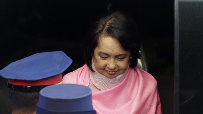 Former Philippine President Gloria Macapagal Arroyo, who is currently under hospital arrest, prepares to be wheeled into the courtroom of the Sandiganbayan (Anti-graft Court) upon arrival for her arraignment Monday, Oct. 29, 2012 at suburban Quezon city, northeast of Manila, Philippines. Arroyo, who is charged with plunder for allegedly misusing state lottery funds, refused to enter a plea and the anti-graft court entered a not guilty plea on her behalf. (AP Photo/Bullit Marquez)
