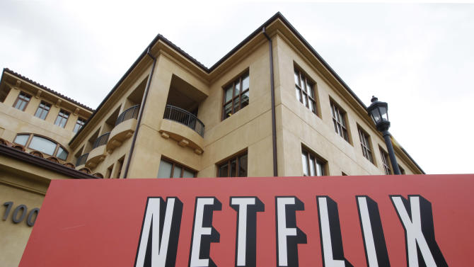 FILE - In this Oct. 10, 2011 file photo, the exterior of Netflix headquarters is seen in Los Gatos, Calif. Netflix subscribers watched more than 1 billion hours of online video last month, a significant milestone that reflects changes in people's viewing habits in the era of mobile devices. It comes as the company tries to wean customers off a DVD service that is more expensive to operate. (AP Photo/Paul Sakuma, File)