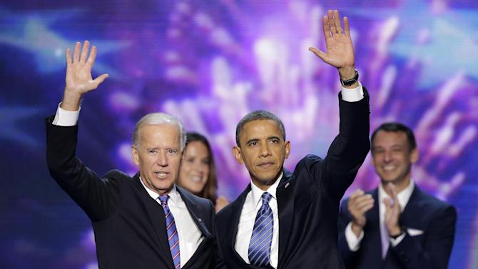 Vice President Joe Biden and President Barack Obama wave to the delegates at the conclusion of Presdident Obama's speech at the Democratic National Convention in Charlotte, N.C., on Thursday, Sept. 6, 2012. (AP Photo/J. Scott Applewhite)