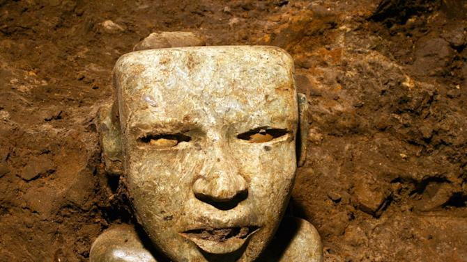This Aug. 6, 2014 photo released by Mexico's National Institute of Anthropology and History (INAH) shows a sculpture unearthed at the Teotihuacan archeological site in Mexico. Mexican archaeologists have concluded a yearslong exploration of a tunnel sealed nearly 2,000 years ago at the ancient city of Teotihuacan and found thousands of relics. Teotihuacan dominated central Mexico centuries before the rise of the Aztecs in the 14th century. (AP Photo/Proyecto Tlalocan, INAH)