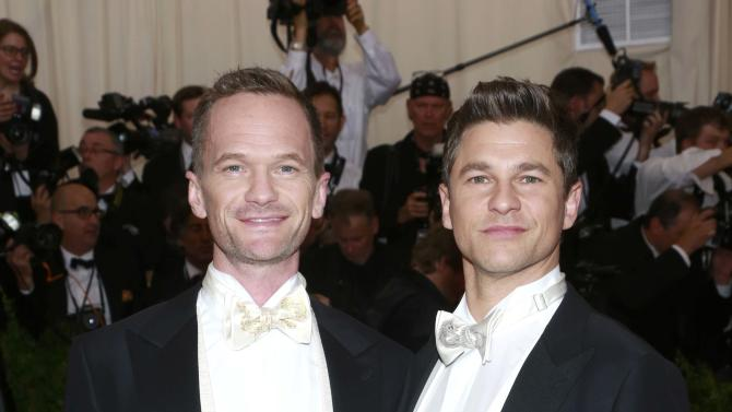 """Actor Harris (L) and his husband Burtka arrive for the Metropolitan Museum of Art Costume Institute Gala 2015 celebrating the opening of """"China: Through the Looking Glass,"""" in Manhattan"""