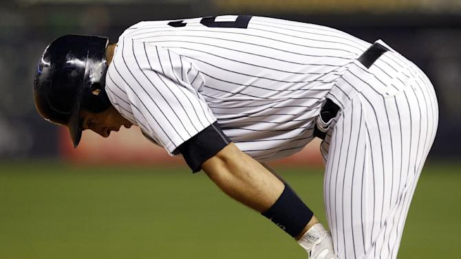 New York Yankees' Mark Teixeira reacts after hitting into a double play in the first inning of a baseball game against the Boston Red Sox at Yankee Stadium in New York, Tuesday, Oct. 2, 2012. (AP Photo/Kathy Willens)
