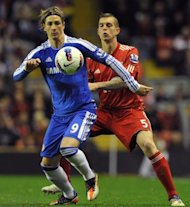 File picture shows Liverpool&#39;s Daniel Agger challenging Spanish striker Fernando Torres. Chelsea&#39;s Spanish forward Fernando Torres (L) vies with Liverpool&#39;s Danish defender Daniel Agger during a Premier League football match at Anfield in May. Liverpool won that match 4-1