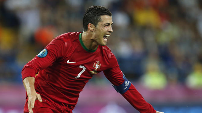 Portugal's Cristiano Ronaldo celebrates his second goal during the Euro 2012 soccer championship Group B match between Portugal and the Netherlands in Kharkiv, Ukraine, Sunday, June 17, 2012. (AP Photo/Armando Franca)