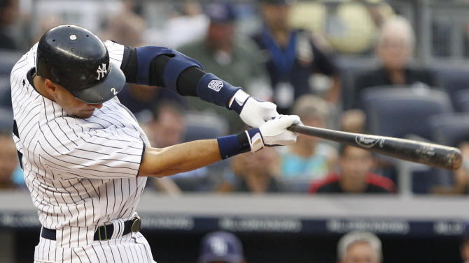 New York Yankees' Derek Jeter follows through on a double during the first inning of a baseball game against the Tampa Bay Rays on Thursday, July 7, 2011, at Yankee Stadium in New York. (AP Photo/Frank Franklin II)