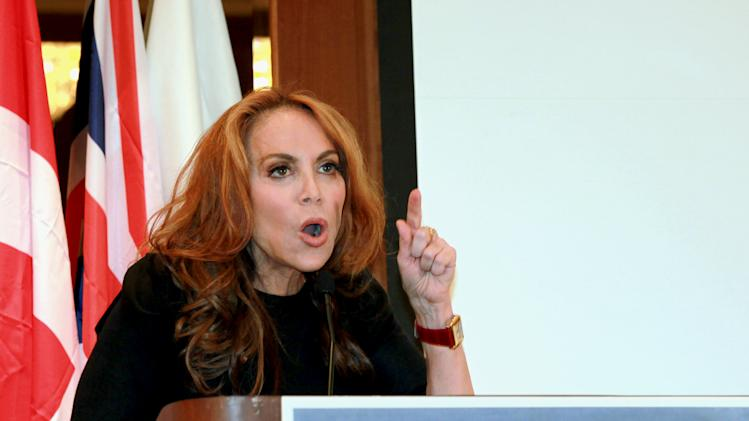 "In this Sept. 11, 2012 photo, anti-Islamic blogger Pamela Geller, speaks at a conference she organized entitled; ""Stop Islamization of America,"" in New York. An advertising campaign initiated by Geller's group, ""The American Freedom Defense Initiative,"" will have its ads that equate foes of Israel with ""savages"" appearing in 10 New York City subway stations after a federal judge ordered the Metropolitan Transportation Authority to put them up. (AP Photo/David Karp)"