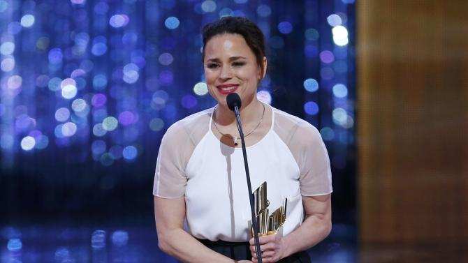"Suzanne Clement accepts the award for best supporting actress for her role in the film ""Mommy"" at the 2015 Canadian Screen Awards in Toronto"