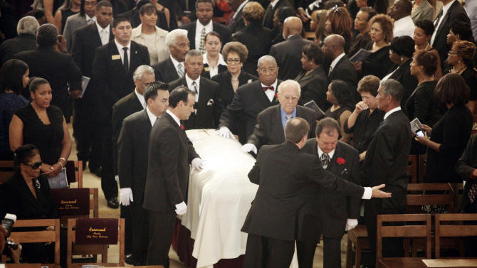 Pallbearers accompany the casket carrying the remains of Mervyn Dymally during his funeral service Wednesday Oct. 17, 2012 in Culver City, Calif. Gov. Jerry Brown and dozens of other prominent officials attended the funeral of the trail-blazing leader, who in a four-decade career served in every corner of California government and eventually became the state's highest-ranking black politician. (AP Photo/Nick Ut)