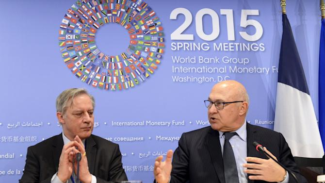 French Finance Minister Sapin and Bank of France Governor Noyer hold a news conference in Washington