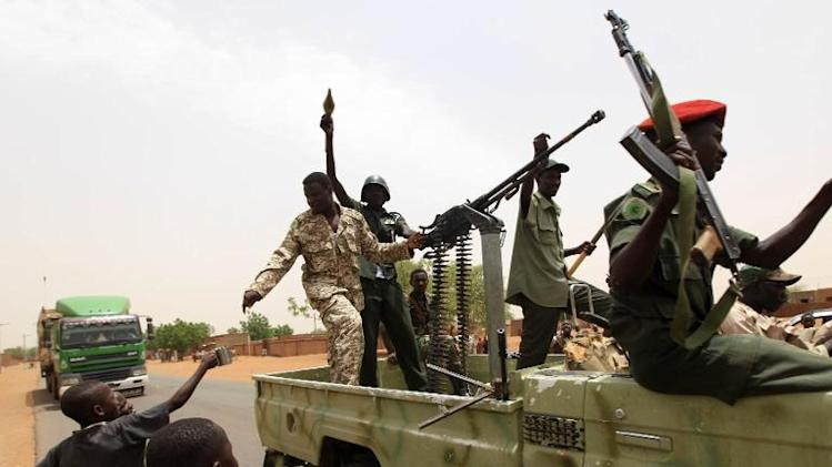 Sudanese forces celebrate after reportedly regaining control of the district of Abu Kershola, in South Kordofan on May 28, 2013