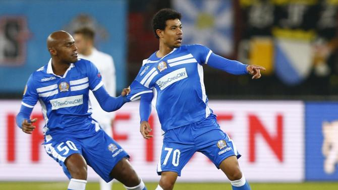 Farley of Apollon Limassol celebrates his first goal against FC Zurich with Paulo during their Europa League Group A soccer match in Zurich