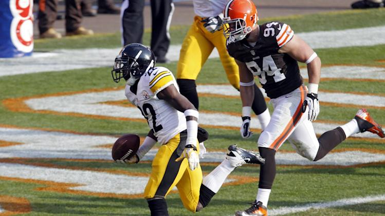 Pittsburgh Steelers running back Chris Rainey beats Cleveland Browns defensive end Auston English (94) to the goal line on a 1-yard touchdown in the second quarter of an NFL football game on Sunday, Nov. 25, 2012, in Cleveland. (AP Photo/Tony Dejak)