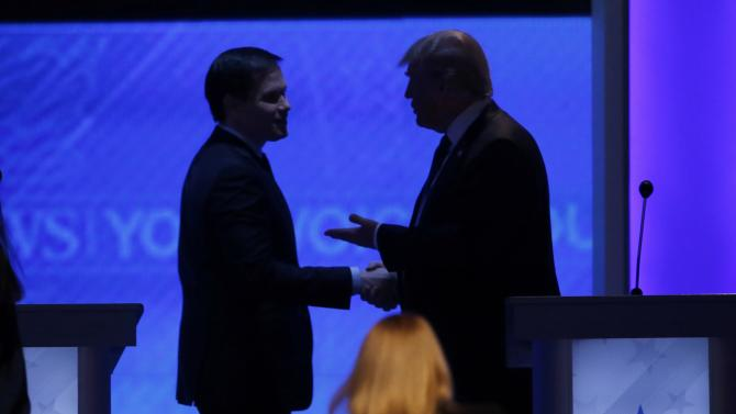 Republican U.S. presidential candidate Rubio shakes hands with Trump during a break in the midst of the Republican U.S. presidential candidates debate sponsored by ABC News at Saint Anselm College in Manchester