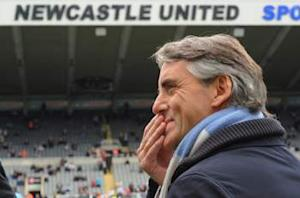Mancini 'excited' by Manchester City victory over Newcastle but insists title race is not over