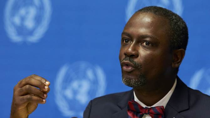 Addy, Liberia's minister for commerce and industry, gestures as he speaks during a news conference on the impact of Ebola at the United Nations European headquarters in Geneva