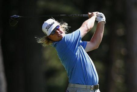 Charley Hoffman of the U.S. tees off on the fourth hole during the third round of the 2013 PGA Championship golf tournament at Oak Hill Country Club in Rochester