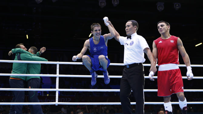 Ireland's Michael Conlan is declared the winner over France's Nordine Oubaali after their Men's Fly (52kg) quarter-final boxing match at the London Olympic Games