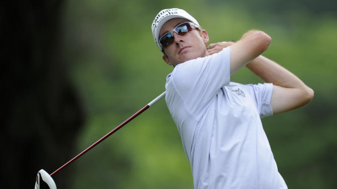 Roberto Castro watches his tee shot on the third tee during the first round of the AT&T National Golf tournament, Thursday, July 27, 2013, in Bethesda, Md. (AP Photo/Nick Wass)