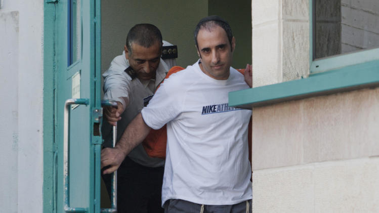 Hagai Amir, who helped plan the assassination of Israeli Prime Minister Yitzhak Rabin, walks out from Ayalon prison, near the city of Ramle, Israel, Friday, May, 4, 2012. Amir helped plan the 1995 killing with his brother Yigal Amir, an ultra-nationalist Jewish extremist, who is serving a life sentence for gunning down the prime minister in Tel Aviv. (AP Photo/Dan Balilty)