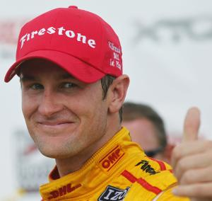 Ryan Hunter-Reay gives a thumbs-up after winning the IndyCar auto race at the Milwaukee Mile in West Allis, Wis., Saturday, June 16, 2012. (AP Photo/Jeffrey Phelps)