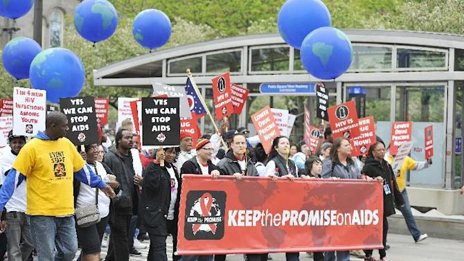"""Advocates marching for the AIDS Healthcare Foundation's """"Keep The Promise On AIDS"""" March and Rally, on Saturday, May 11, 2013 in Cleveland, Ohio. (Jason Miller /AP Images for AIDS Healthcare Foundation)"""