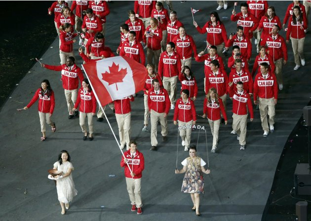 Canada's flagbearer Simon Whitfield leads the contingent in the athletes parade during the opening ceremony of the London 2012 Olympic Games at the Olympic Stadium