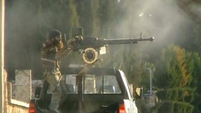 Rebels under fire in Syria as they claim government complex