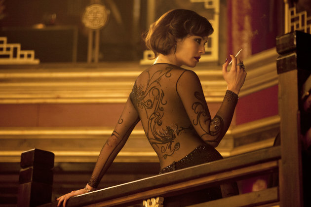 "This film image released by Sony Pictures shows Berenice Marlohe in a scene from the film ""Skyfall."" Costume designer Jany Temime says her mantra for the entire wardrobe of ""Skyfall,"" which opens Friday, was ""iconic for 2012."" For Marlohe, Temime envisioned an Ava Gardner type. She required two knockout gowns, one a second-skin L'Wren Scott number that Marlohe had to be sewn into each morning, and a red, slinky Donna Karan. (AP Photo/Sony Pictures, Francois Duhamel)"