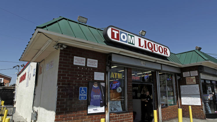 This April 20, 2012 photo shows Tom's Liquor at the corner of Florence and Normandie in Los Angeles. Twenty years since the 1992 LA riots residents of the city's largely black and Hispanic South Side complain that the area still is plagued by too few jobs, too few grocery stores and a lack of redevelopment that would bring more life to the area. (AP Photo/Matt Sayles)